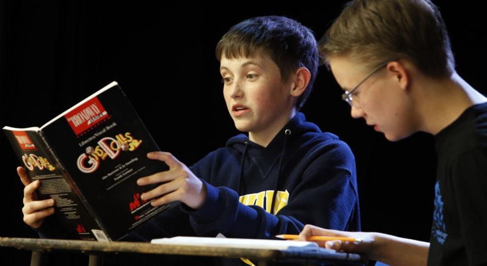 Zach Abell, left, reads the part of Nicely-Nicely as Zach Jones studies for the part of Sky Masterson in Irving Middle School�s upcoming production of �Guys and Dolls Junior.� PHOTO BY STEVE SISNEY, THE OKLAHOMAN