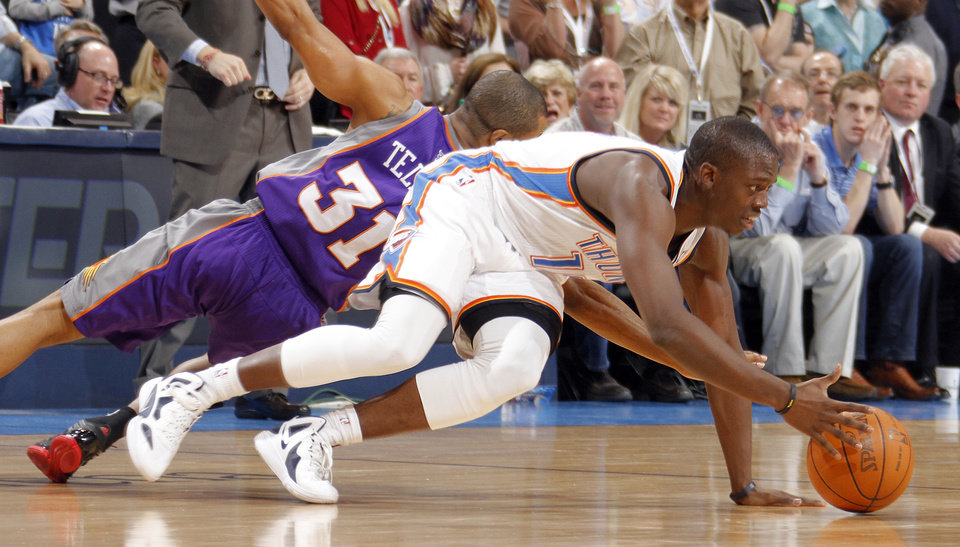 Oklahoma City Thunder guard Reggie Jackson (15) battles for a loose ball with Phoenix Suns point guard Sebastian Telfair (31) during the NBA basketball game between the Oklahoma City Thunder and the Phoenix Suns at the Chesapeake Energy Arena on Wednesday, March 7, 2012 in Oklahoma City, Okla. Photo by Chris Landsberger, The Oklahoman