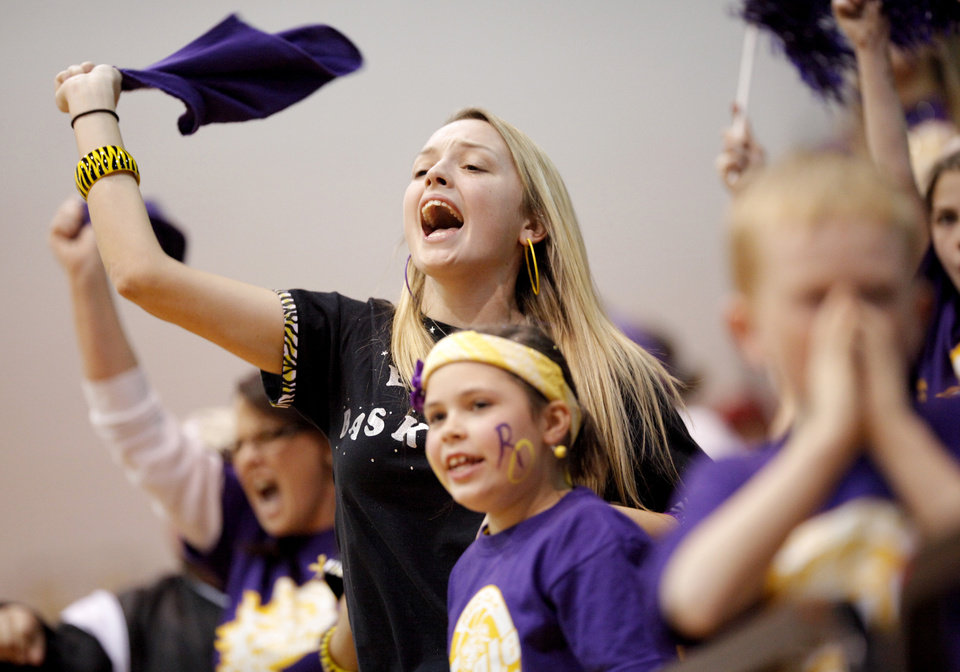 Photo - Cheyenne Booth, 17, of Red Oak cheers for the Red Oak team as they play Timberlake in the Class B boys state high school basketball tournament at Carl Albert High School in Midwest City, Okla., Thursday, March 4, 2010.  Photo by Bryan Terry, The Oklahoman