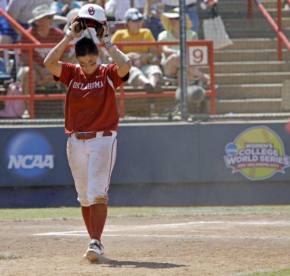 Photo - Oklahoma's Ali Vandever (8) walks off the field after losing a Women's College World Series softball game between the University Oklahoma and Missouri at ASA Hall of Fame Stadium in Oklahoma City, Saturday, June 4, 2011.  Missouri won, 4-1.  Photo by Bryan Terry, The Oklahoman