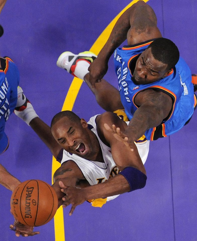 Los Angeles� Kobe Bryant, bottom, battles for a rebound against OKC�s Kendrick Perkins during the Thunder�s win on Sunday in Los Angeles. AP photo