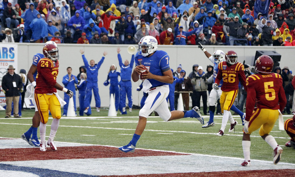 Photo - Tulsa quarterback Cody Green (7) sprints into the end zone with a 7-yard second-quarter touchdown run in the Liberty Bowl NCAA college football game in Memphis, Tenn., Monday, Dec. 31, 2012. (AP Photo/Rogelio V. Solis)