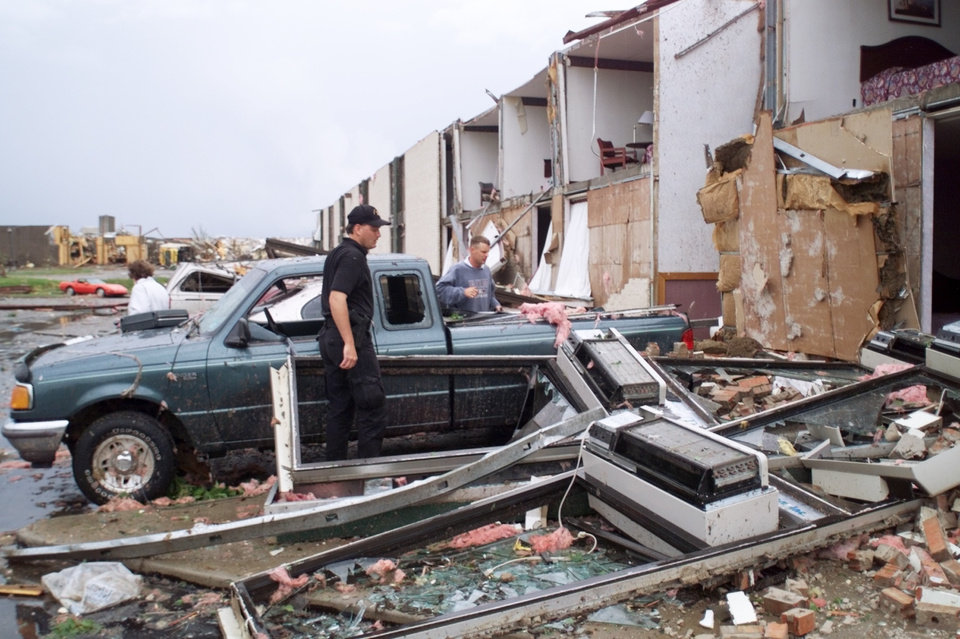 MAY 3, 1999 TORNADO: Emergency workers look through the remains of the Comfort Inn at I-40 and Sooner Road in Midwest City.