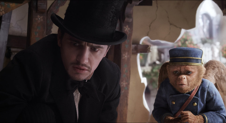 James Franco, as Oz, left, talks with the flying monkey Finley, voiced by Zach Braff, in a scene from �Oz the Great and Powerful.� Disney Enterprises Photo
