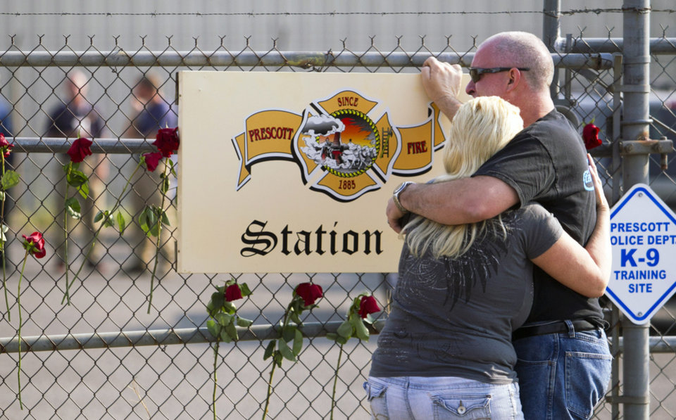 Photo - David Turbyfill, father of firefighter Travis Turbyfill, who was killed fighting the Yarnell Hill Fire, is comforted by his wife, Shari Turbyfill in front of Prescott Fire Station 7 on Monday, July 1, 2013 in Prescott, Ariz. Nineteen of the 20 members of the elite firefighting team were killed Sunday when a wildfire suddenly swept toward them in Yarnell, Ariz. (AP Photo/The Arizona Republic, David Wallace)