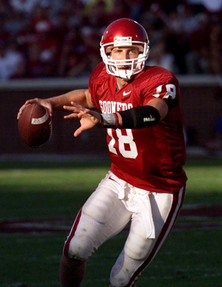 Photo -  COLLEGE FOOTBALL: University of Oklahoma vs Baylor University in Norman, Okla. on Saturday October 20, 2001. OU quarterback Jason White scrambles looking for a receiver late in the game. Staff photo by Doug Hoke.