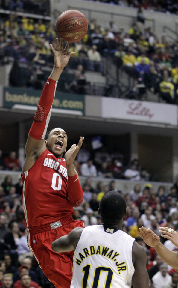 Photo -   \Ohio State forward Jared Sullinger (0) goes up for a shot in the first half of an NCAA college basketball game against Michigan in the semifinals of the Big Ten Conference tournament in Indianapolis, Saturday, March 10, 2012. At right is Michigan guard Tim Hardaway Jr. (10). (AP Photo/Michael Conroy)