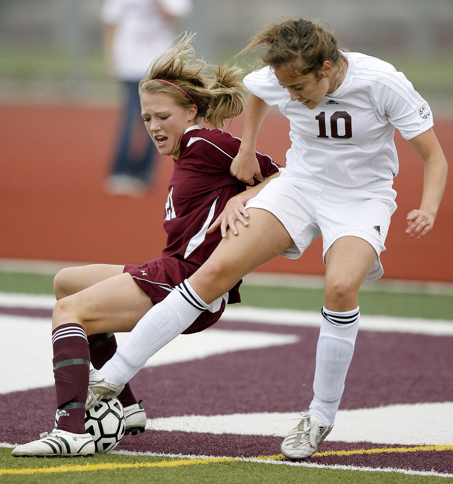 She Charbeneau of Edmond Memorial, right, and Heidi Greeson of Jenks fight for control during their Class 6A girls playoff soccer game in Edmond, Okla., Tuesday, May 12, 2009. Photo by Bryan Terry, The Oklahoman