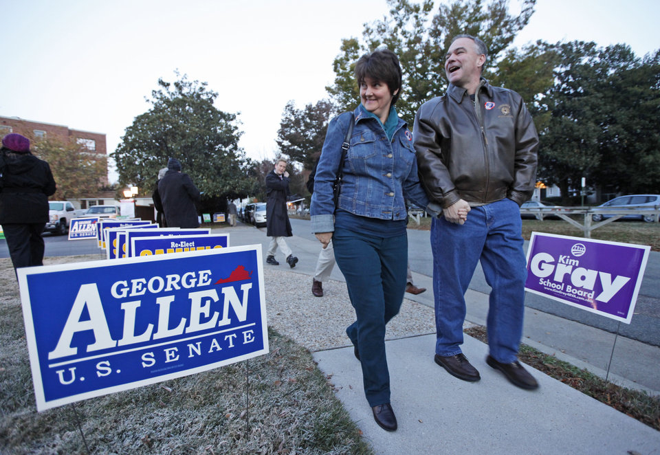 Democratic Senate candidate, former Gov. Timothy Kaine, and his wife, Anne Holton, walk back home after voting in Richmond, Va., Tuesday, Nov. 6, 2012. (AP Photo/Steve Helber)