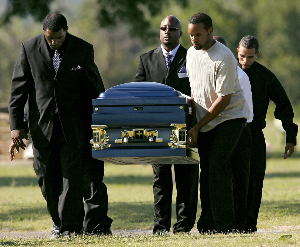 Photo - REV. CAROL DANIELS / MURDER / HOMICIDE: Pallbearers carry Carol Daniels' casket at Arlington Memorial Gardens in Oklahoma City during her funeral on Monday, August 31, 2009.  By John Clanton, The Oklahoman ORG XMIT: KOD