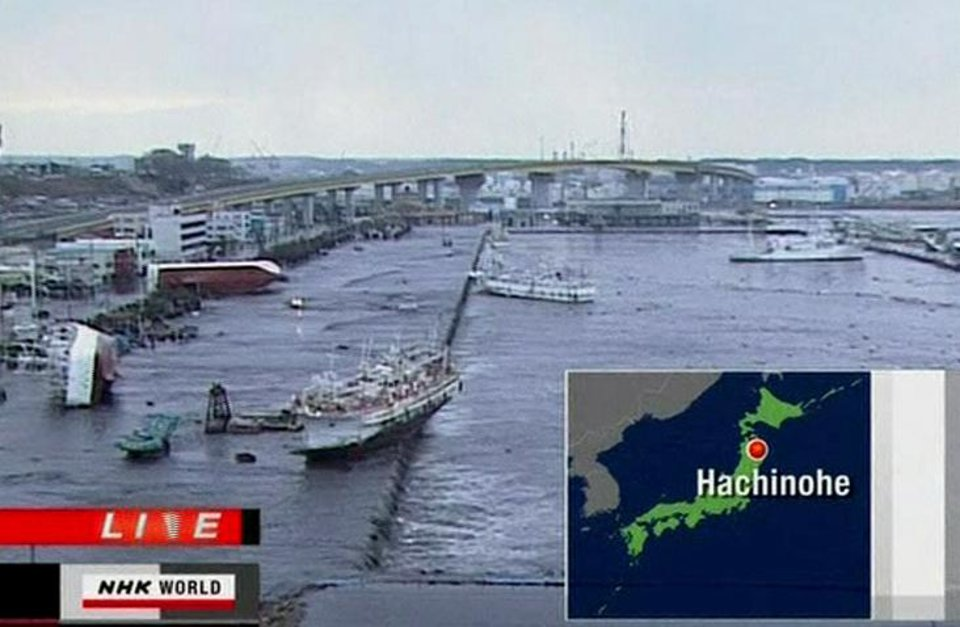 Photo - In this video image taken from Japan's NHK TV, ships and boats are washed ashore in Hachinohe, Aomori Prefectur, Japan Friday March 11, 2011 following a masive earth quake. A magnitude 8.9 earthquake slammed Japan's northeastern coast Friday, unleashing a 13-foot (4-meter) tsunami that swept boats, cars, buildings and tons of debris miles inland. Fires triggered by the quake burned out of control up and down the coast.  (AP PHOTO/NHK TV) MANDATORY CREDIT, JAPAN OUT, TV OUT,  NO SALES, EDITORIAL USE ONLY ORG XMIT: LON801