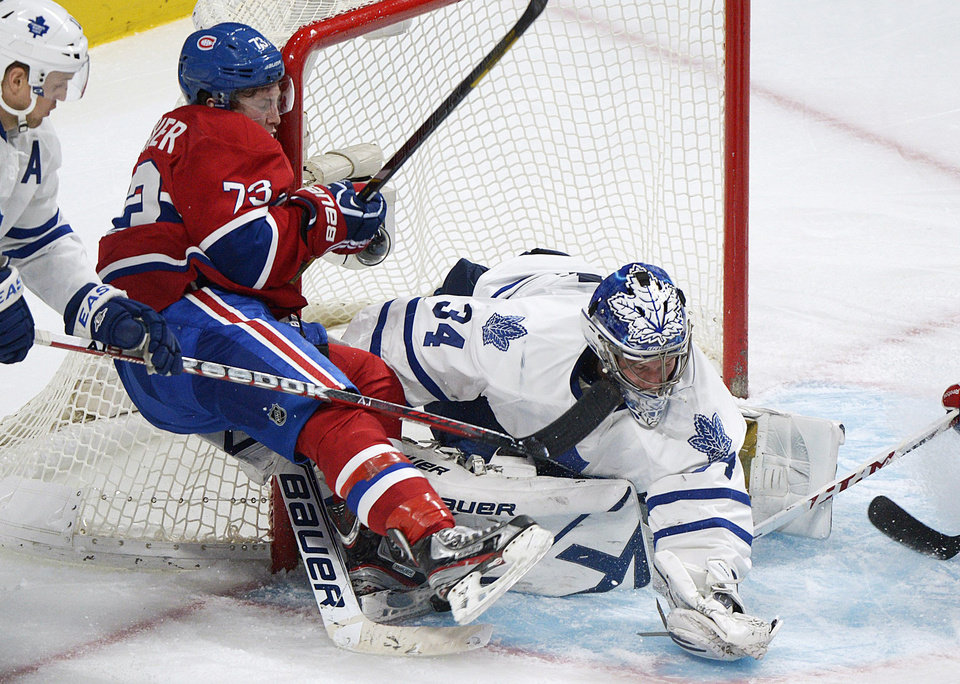Toronto Maple Leafs goaltender James Reimer makes a save against Montreal Canadiens' Brendan Gallagher, left, during the third period of an NHL hockey game in Montreal, Saturday, Feb. 9, 2013. (AP Photo/The Canadian Press, Graham Hughes)
