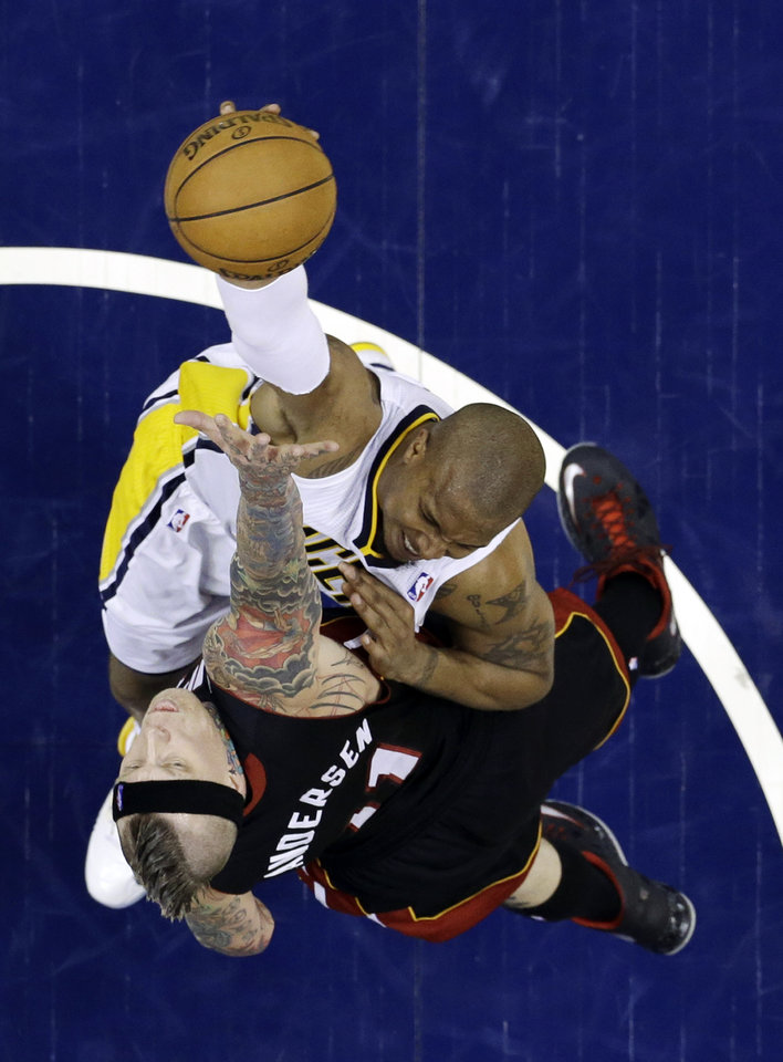 Indiana Pacers' David West, top, puts up a shot against Miami Heat's Chris Andersen during the second half of Game 3 of the NBA Eastern Conference basketball finals in Indianapolis, Sunday, May 26, 2013. (AP Photo/Michael Conroy)
