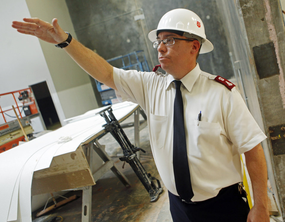 Photo -  Capt. Carlyle Gargis, commander of the Salvation Army Central Oklahoma Command, shows off a nearly finished room during a construction walk-through of the new Salvation Army Chesapeake Energy Center of Hope at 1001 N Pennsylvania Ave. Photo by KT King, The Oklahoman   KT King -