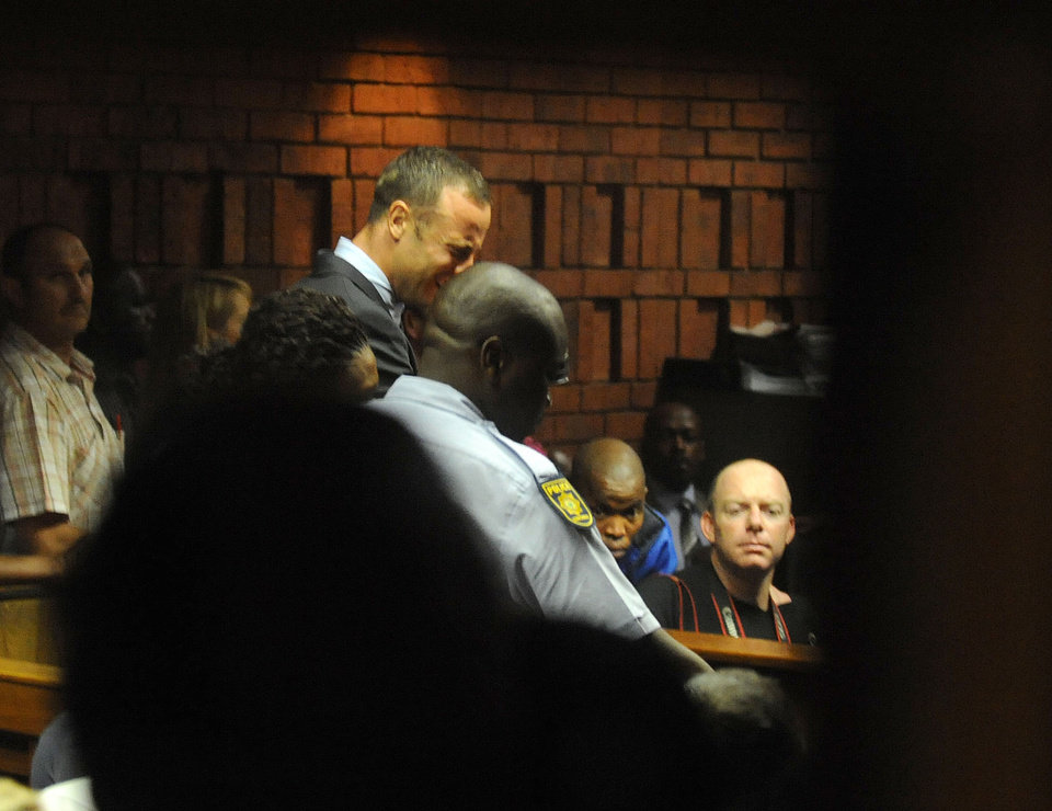 South African athlete Oscar Pistorius reacts,  in court in Pretoria, South Africa, Friday, Feb 15, 2013, at his bail hearing in the murder case of his girlfriend Reeva Steenkamp.  Pistorius was formally charged at Pretoria Magistrate�s Court with one count of murder after his girlfriend, Reeva Steenkamp, a model and budding reality TV show participant, was shot multiple times and killed at Pistorius' upmarket home in the predawn hours of Thursday.  (AP Photo/Antione de Ras - Independent Newspapers Ltd South Africa-Star) SOUTH AFRICA OUT. NO MAGS