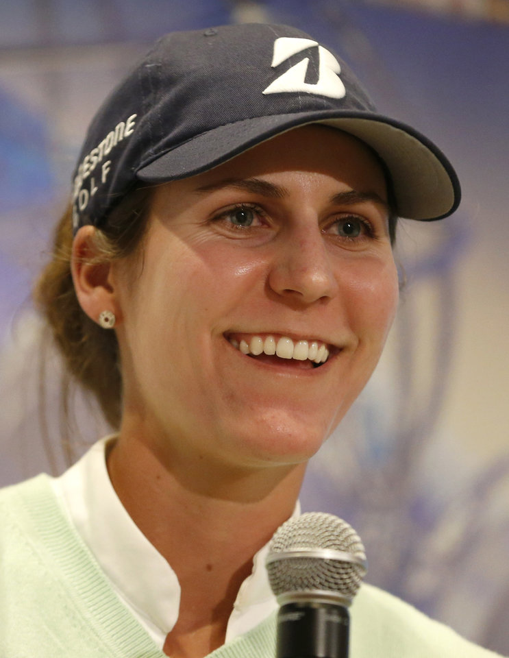 Photo - Jennifer Johnson smiles during a news conference following her performance in the first round of the ShopRite LPGA Classic golf tournament in Galloway Township, N.J., Friday, May 30, 2014. (AP Photo/Julio Cortez)