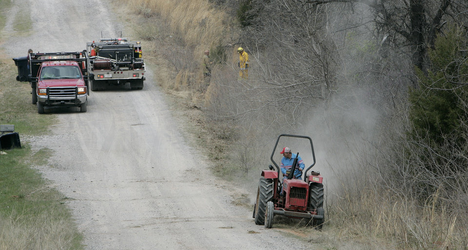 Firecrews monitor a grass fire east of Hill Top Road and 149th ave. Fri. April 10, 2009. Photo by Jaconna Aguirre, The Oklahoman.