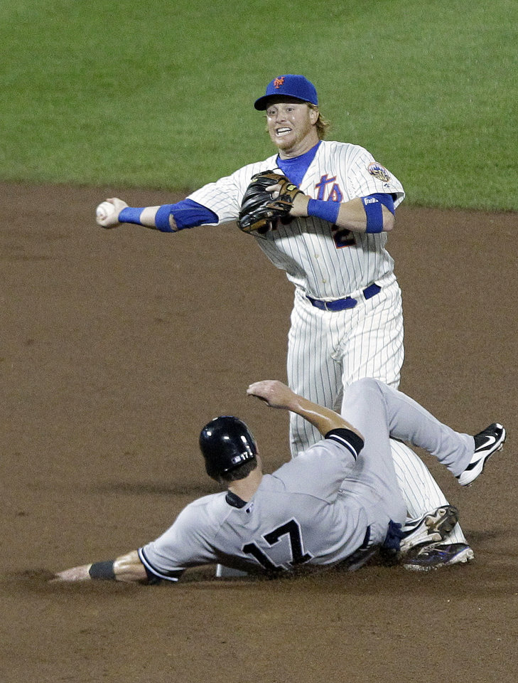 Photo -   New York Mets second baseman Justin Turner, top, throws to first base after forcing out New York Yankees' Jayson Nix (17) during the seventh inning of an interleague baseball game on Friday, June 22, 2012, in New York. (AP Photo/Frank Franklin II)
