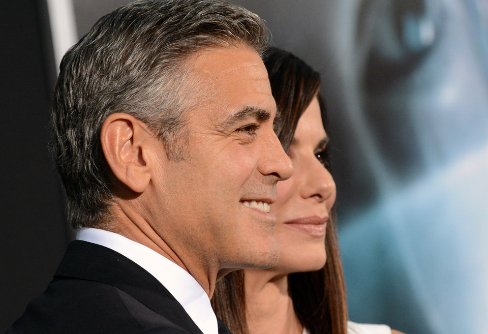 "Actors George Clooney and Sandra Bullock attend the premiere of ""Gravity"" at the AMC Lincoln Square Theaters on Tuesday, Oct. 1, 2013 in New York. (Photo by Evan Agostini/Invision/AP)"