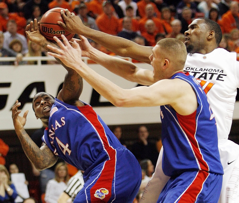 From left, Sherron Collins (4) and Cole Aldrich (45) of KU along with OSU's Matt Pilgrim (31) attempt to rebound the ball in the first half during the men's college basketball game between the University of Kansas (KU) and Oklahoma State University (OSU) at Gallagher-Iba Arena in Stillwater, Okla., Saturday, Feb. 27, 2010. Photo by Nate Billings, The Oklahoman
