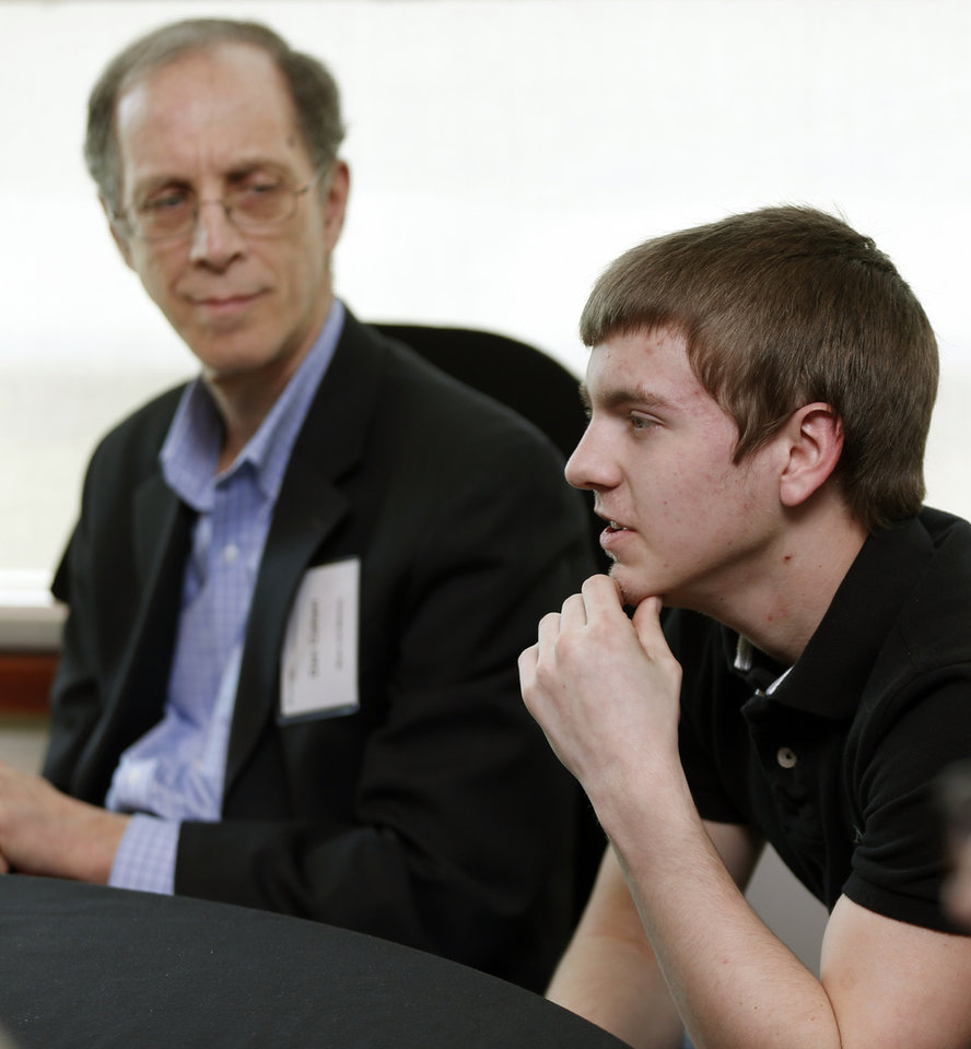 Photo - Blake Lowe, 18, an honor student from Blanchard, talks during a meeting with Dan Cohen, executive director of Music and Memory, left, before a showing of the documentary