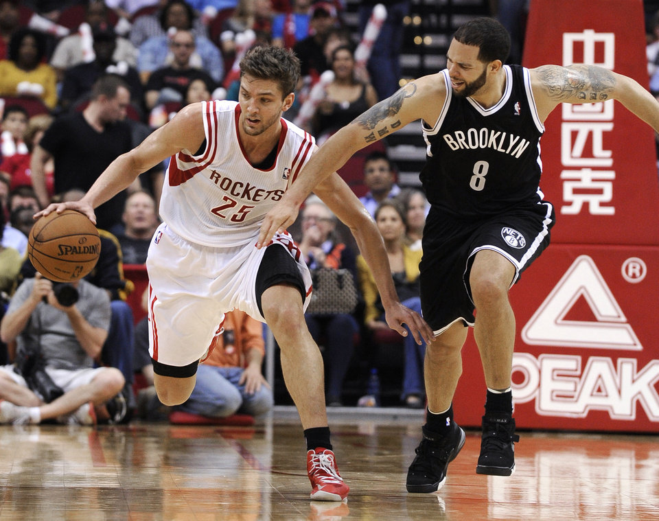 Brooklyn Nets' Deron Williams (8) chases Houston Rockets' Chandler Parsons (25) during the second half of an NBA basketball game Saturday, Jan. 26, 2013, in Houston. The Rockets won 119-106. (AP Photo/Pat Sullivan)