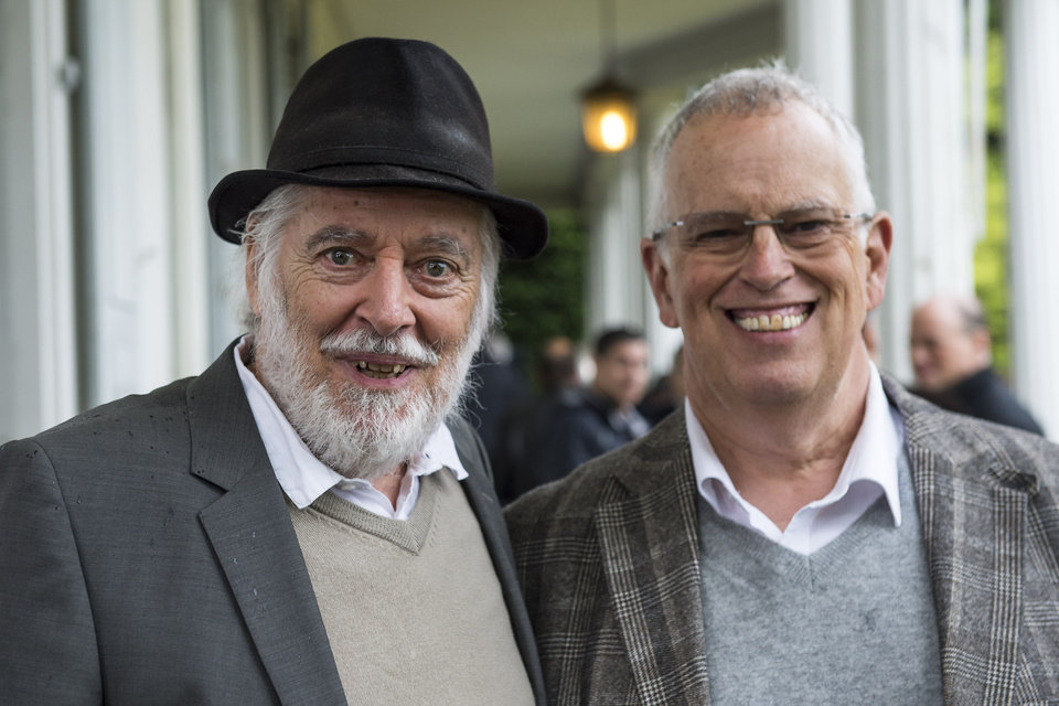"Photo - Michael Chaplin, left, and Eugene Chaplin, right, sons of Charlie Chaplin, pose for photographers in the garden of the Swiss mansion where their famous father lived the last 25 years of his life. Chaplin's family and supporters gathered Wednesday, May 7, 2014, to discuss the future of the Charlie Chaplin Museum planned at the Manoir de Ban, an estate along Lake Geneva in Corsier-sur-Vevey, Switzerland. The museum, called ""Chaplin's World"
