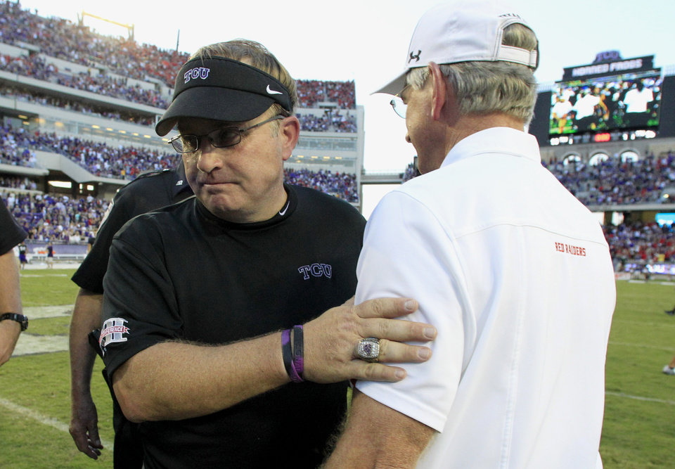 TCU head coach Gary Patterson, left, begins to head off the field after shaking hands with Texas Tech head coach Tommy Tuberville after their NCAA college football game, Saturday, Oct. 20, 2012, in Fort Worth, Texas. Texas Tech won 56-53 in triple overtime. (AP Photo/LM Otero) ORG XMIT: TXMO125
