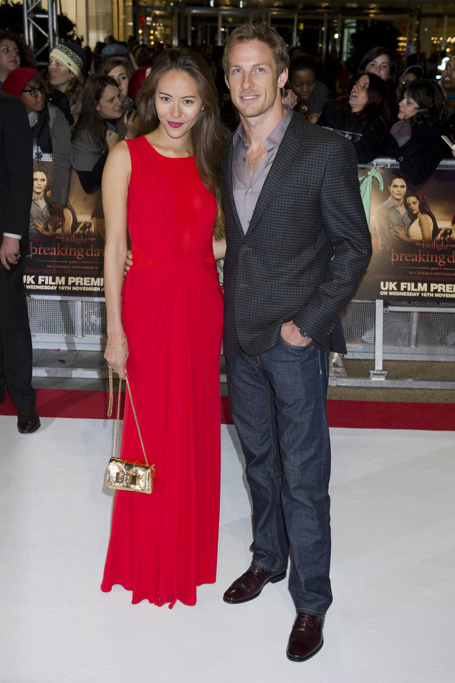 British racing driver Jenson Button and Jessica Michibata arrive for the UK premiere of 'Twilight Breaking Dawn Part 1' at a central London venue,  Wednesday, Nov. 16, 2011. (AP Photo/Jonathan Short) ORG XMIT: LJS116
