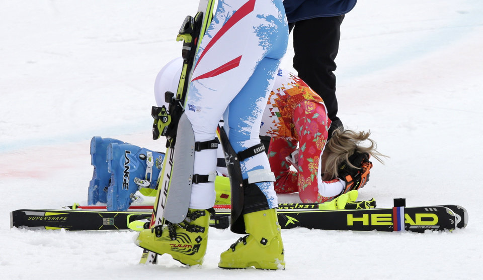 Photo - Germany's Maria Hoefl-Riesch drops to her knees the moment she realizes she has won the gold medal in the women's supercombined at the Sochi 2014 Winter Olympics, Monday, Feb. 10, 2014, in Krasnaya Polyana, Russia. (AP Photo/Gero Breloer)