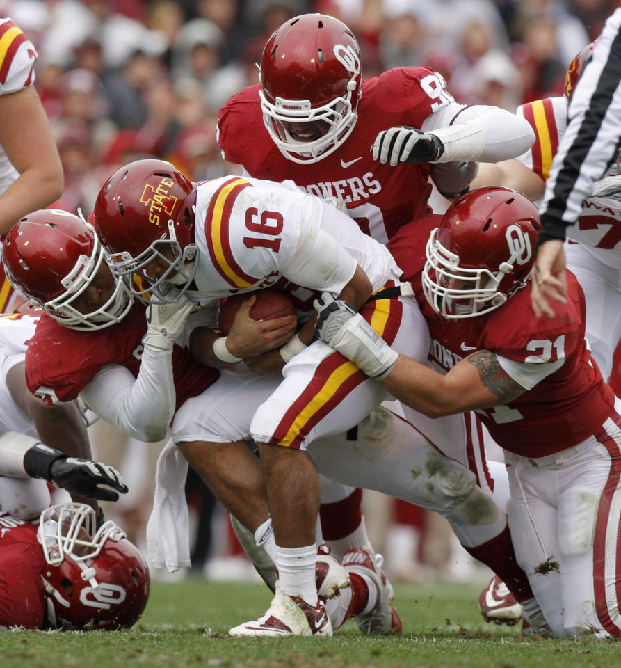 Oklahoma\'s Corey Nelson (7) David King (90) and Tom Wort (21) bring down Iowa State\'s Jared Barnett (16) during a college football game between the University of Oklahoma Sooners (OU) and the Iowa State University Cyclones (ISU) at Gaylord Family-Oklahoma Memorial Stadium in Norman, Okla., Saturday, Nov. 26, 2011. Photo by Bryan Terry, The Oklahoman