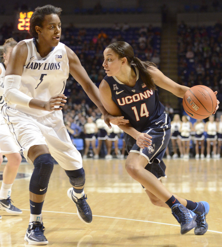 Photo - Connecticut's Bria Hartley (14) drives to the basket past Penn State's Talia East (5) in the first half of an NCAA college basketball game on Sunday, Nov. 17, 2013, in State College, Pa. Hartley had 29 points in Connecticut's 71-52 victory over Penn State. (AP Photo/John Beale)