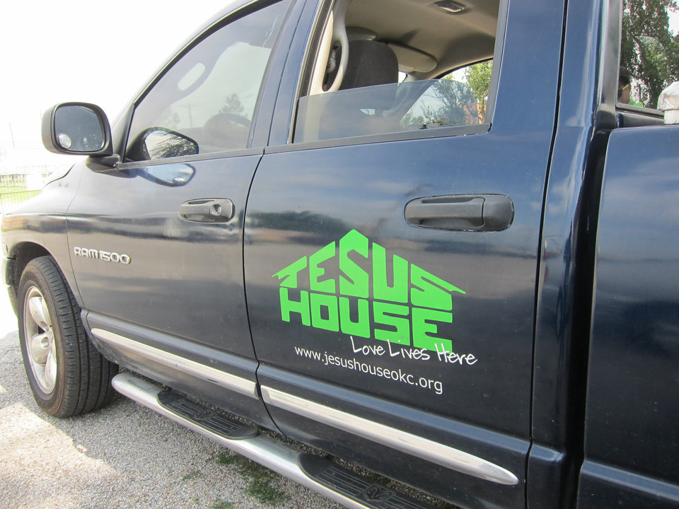 Photo -  A Jesus House truck prepares to take a group of the shelter's residents to nearby neighborhoods as part of the Jesus House's Adopt-A-Block program. Photo by Carla Hinton, The Oklahoman