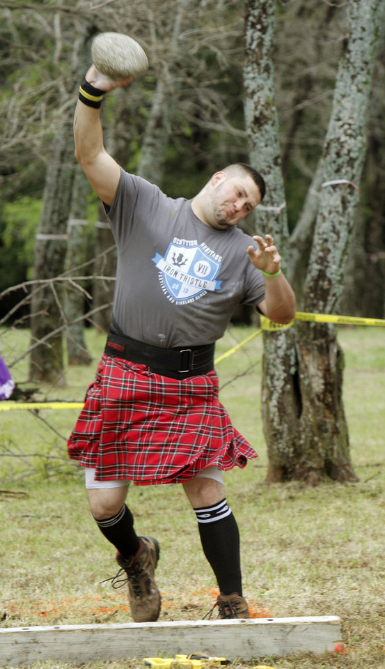 James Pitts competes in the stone put event during the Iron Thistle Scottish Heritage Festival in Yukon, OK, Saturday, April 27, 2013,  By Paul Hellstern, The Oklahoman