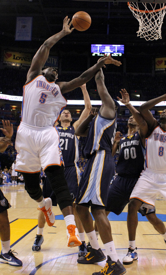 Oklahoma City's Kendrick Perkins (5) puts up a shot beside Greivis Vasquez (21) Zach Randolph (50) and Darrell Arthur (00) of Memphis during game two of the Western Conference semifinals between the Memphis Grizzlies and the Oklahoma City Thunder in the NBA basketball playoffs at Oklahoma City Arena in Oklahoma City, Tuesday, May 3, 2011. Photo by Bryan Terry, The Oklahoman