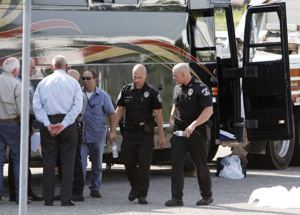 Photo - Oklahoma City police and Oklahoma County sheriff's department  investigators use a search warrant to search the 2 Chainz tour bus at the police training center in Oklahoma City, OK, Thursday, August 22, 2013.  Photo by Paul Hellstern, The Oklahoman