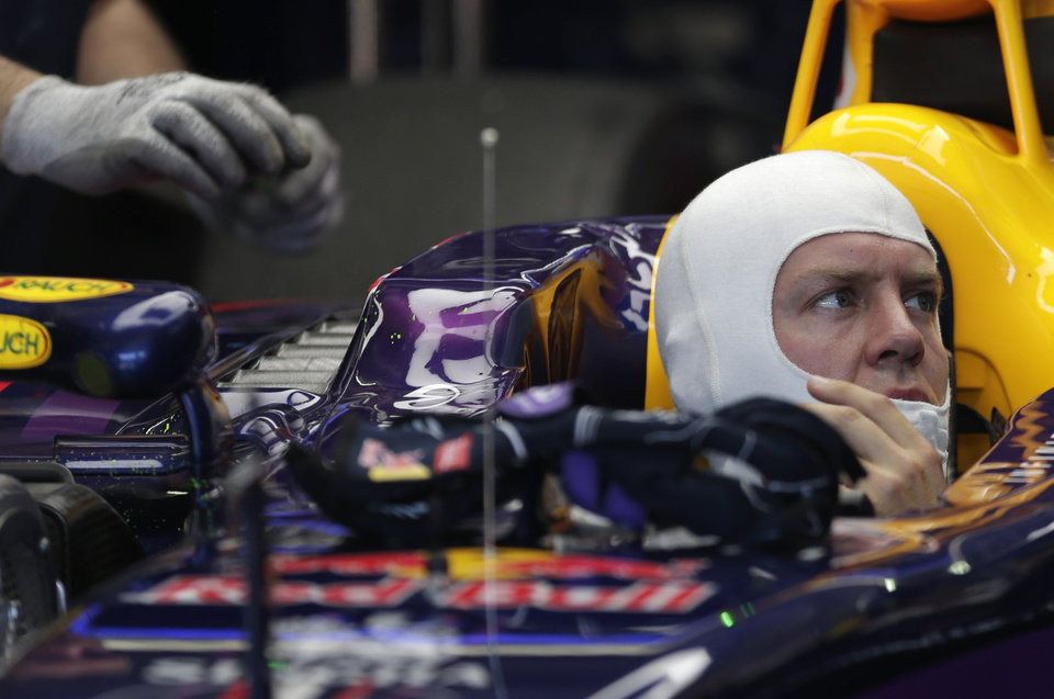 Photo - Red Bull driver Sebastian Vettel of Germany prepares for the free practice session at the German Formula One Grand Prix in Hockenheim, Germany, Friday, July 18, 2014. The German Grand Prix will be held on Sunday, July 20, 2014. (AP Photo/Petr David Josek)