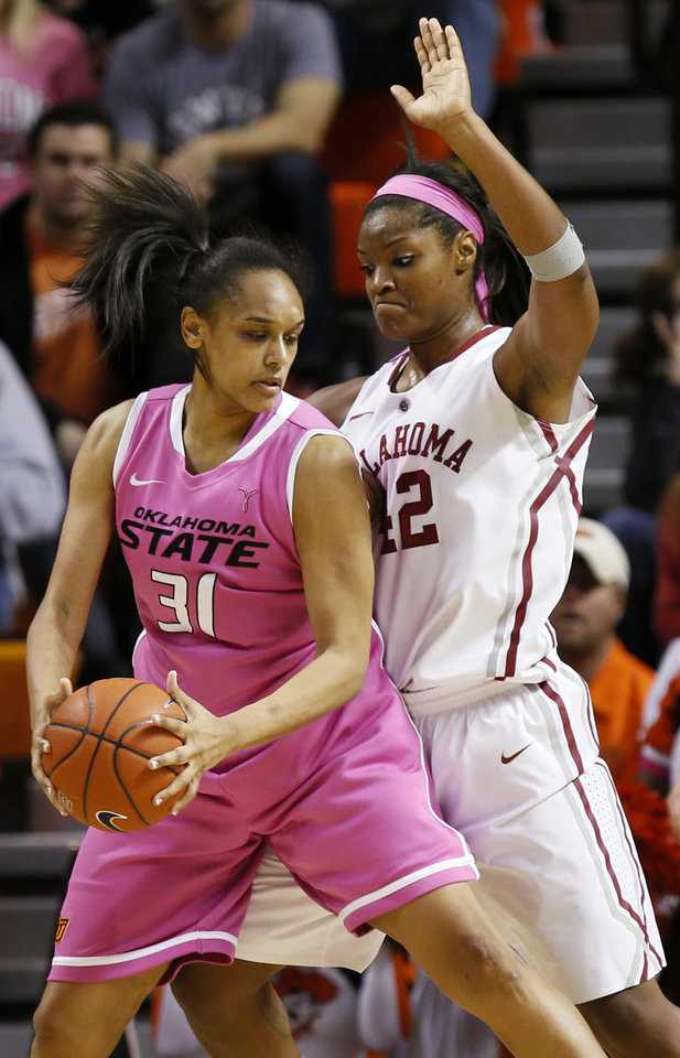 Photo - Oklahoma State's Kendra Suttles (31) works against Oklahoma's Kaylon Williams (42) in the second half during the women's Bedlam college basketball game between the OU Sooners and the OSU Cowgirls at Gallagher-Iba Arena in Stillwater, Okla., Sunday, Feb. 16, 2014. OSU won, 73-57. Photo by Nate Billings, The Oklahoman