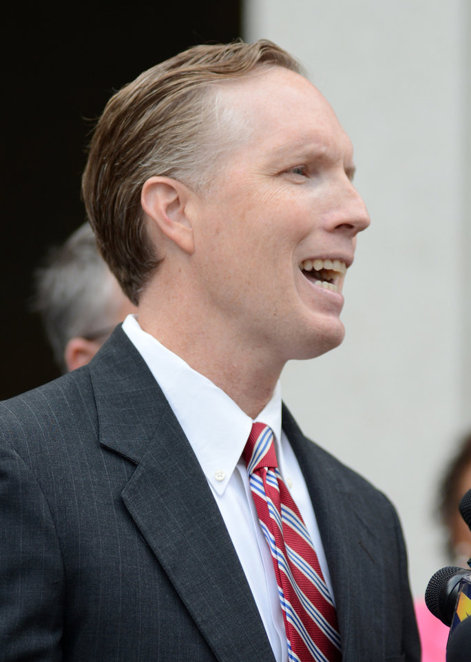 Photo - Assistant US Attorney Matt Coman speaks to reporters outside Federal Court after the sentencing of former New Orleans Mayor Ray Nagin, in New Orleans, Wednesday, July 9, 2014. Nagin was sentenced Wednesday to 10 years in prison for bribery, money laundering and other corruption that spanned his two terms as mayor, including the chaotic years after Hurricane Katrina hit in 2005. He was convicted Feb. 12 of accepting hundreds of thousands of dollars from businessmen who wanted work from the city or Nagin's support for various projects. The bribes came in the form of money, free vacations and truckloads of free granite for his family business. (AP Photo/Andrea Mabry)