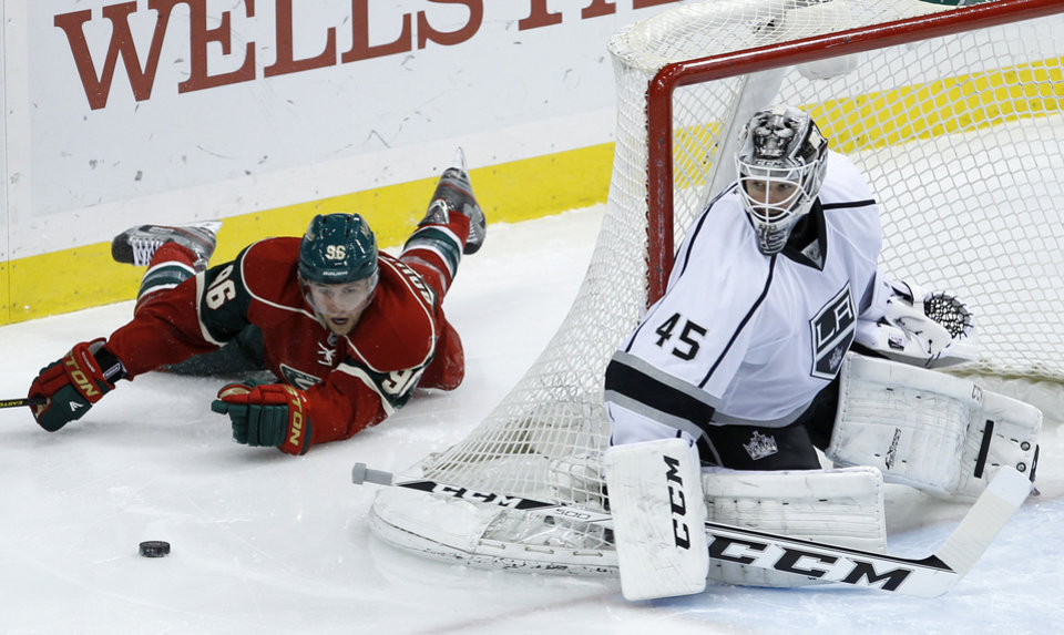 Photo - Minnesota Wild right wing Pierre-Marc Bouchard (96) can't get to the puck as Los Angeles Kings goalie Jonathan Bernier (45) covers the net during the third period of an NHL hockey game in St. Paul, Minn., Tuesday, April 23, 2013. The Wild beat the Kings 2-1.(AP Photo/Ann Heisenfelt)