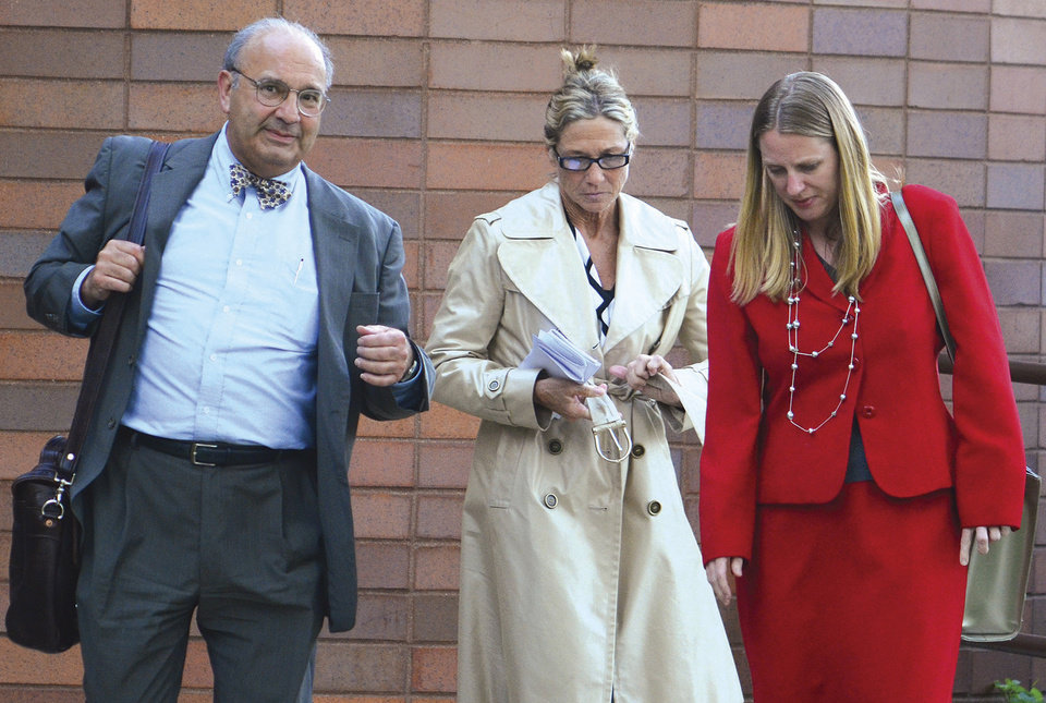 Photo -   In this April 18, 2012 photo, Rita Crundwell, center, the comptroller in Dixon, Ill., leaves federal court in Rockford, Ill. with attorneys Paul Gaziano, left, and Kriston Carpenter after being freed on a recognizance bond. Crundwell was arrested April 17, accused of stealing $30 million from the city of Dixon to fund a lavish lifestyle and run one of the nation's leading horse breeding operations. (AP Photo/Sauk Valley Newspapers, Chris Johnson)