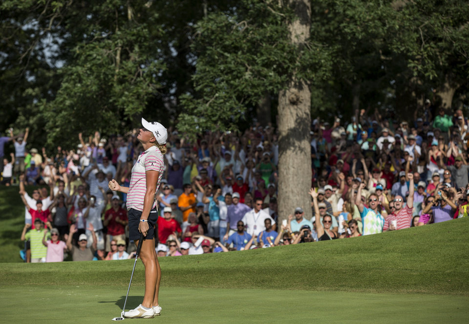 Photo - Stacy Lewis reacts to making a 7 foot birdie putt during the final round of the NW Arkansas Championship golf tournament on Sunday, June 29, 2014, in Rogers, Ark. Lewis won the tournament. (AP Photo/Beth Hall)