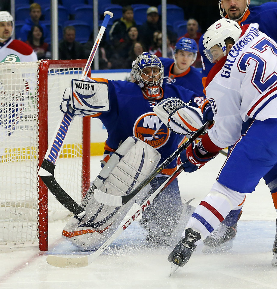 New York Islanders goalie Evgeni Nabokov (20) makes a save against a shot by Montreal Canadiens center Alex Galchenyuk (27) during the first period of an NHL hockey game at the Nassau Coliseum in Uniondale, N.Y., Tuesday, March 5, 2013. (AP Photo/Paul J. Bereswill)
