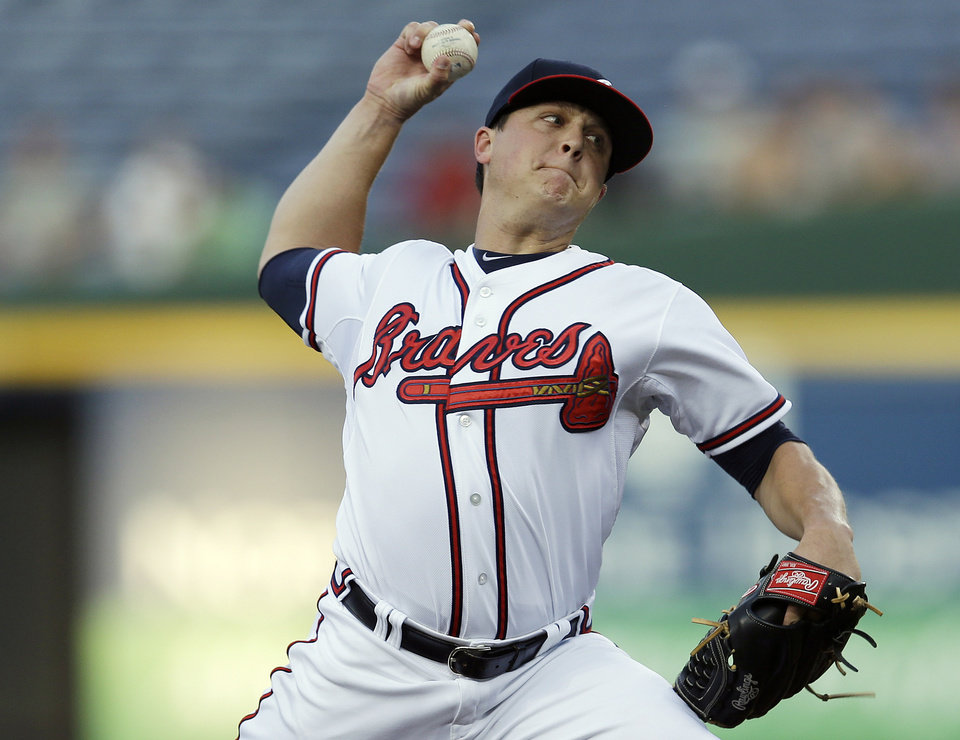 Atlanta Braves starting pitcher Kris Medlen works in the first inning of a baseball game against the New York Mets Tuesday, Sept. 3, 2013 in Atlanta. (AP Photo/John Bazemore)