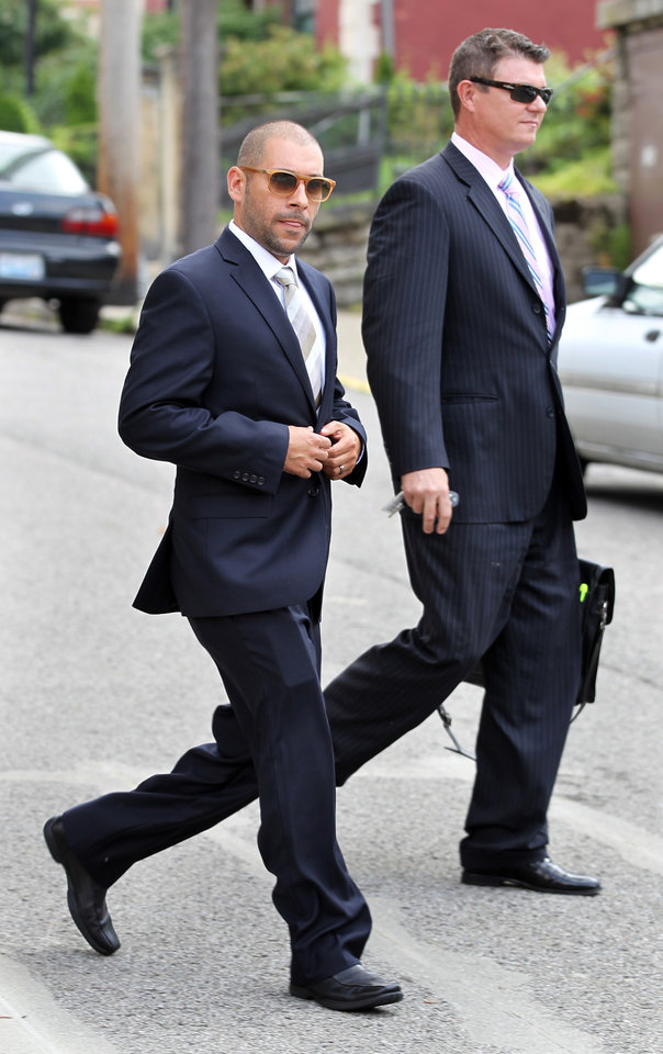 Photo - FILE - In this July 11, 2013 file photo, Nik Richie, left, owner of the gossip website TheDirty.com, leaves the Federal Courthouse in Covington, Ky., with his lawyer, David Gingra. An appeals court found Monday, June 16, 2014 that an Arizona-based gossip website should have been immune from being sued by Jones over online posts that she was promiscuous and had sexually transmitted diseases.The decision from the Cincinnati-based 6th U.S. Circuit Court of Appeals reverses a federal Kentucky judge's decision allowing the lawsuit to proceed. (AP Photo/Cincinnati Enquirer, Patrick Reddy) MANDATORY CREDIT;  NO SALES
