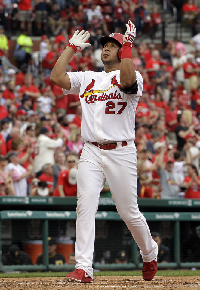 Photo - St. Louis Cardinals' Jhonny Peralta celebrates as he reaches home after hitting a solo home run during the fifth inning of a baseball game against the Pittsburgh Pirates, Sunday, April 27, 2014, in St. Louis. Peralta also hit a three-run home run in the sixth inning to help the Cardinals to a 7-0 victory. (AP Photo/Jeff Roberson)