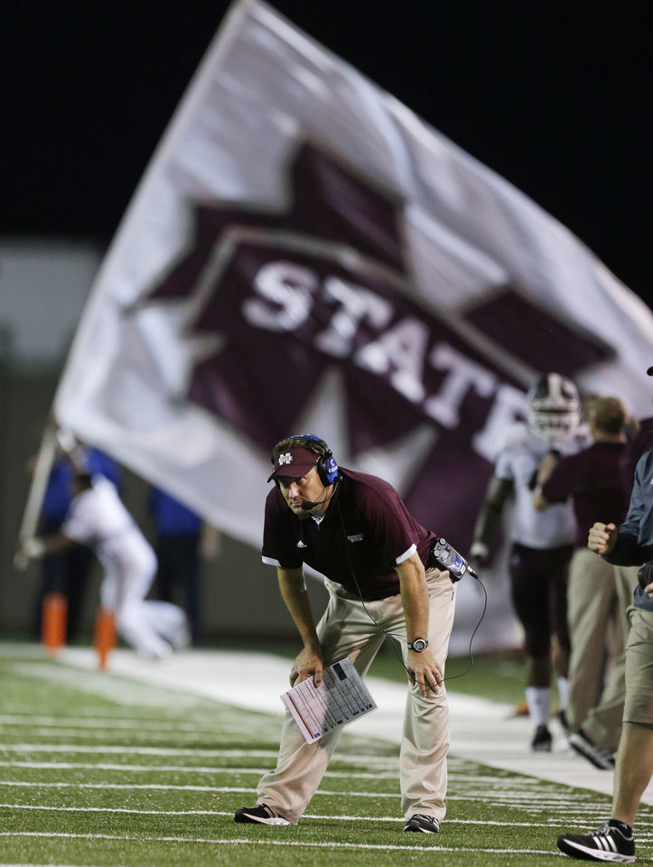 Photo -   Mississippi State Coach Dan Mullen watches from the sideline after his team scored a touchdown against Troy in the first half of a NCAA college football game in Troy, Ala., Saturday, Sept. 15, 2012. (AP Photo/Dave Martin)