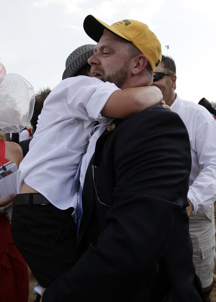 Photo - Trainer Doug O'Neill hugs his son Daniel after I'll Have Another wins the 138th Kentucky Derby horse race at Churchill Downs Saturday, May 5, 2012, in Louisville, Ky. (AP Photo/Matt Slocum)  ORG XMIT: DBY208
