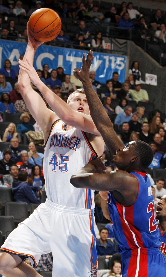 Photo - Oklahoma City's Cole Aldrich (45) shoots over Vernon Macklin (20) of Detroit during the NBA basketball game between the Detroit Pistons and Oklahoma City Thunder at the Chesapeake Energy Arena in Oklahoma City, Monday, Jan. 23, 2012. Oklahoma City won, 99-79. Photo by Nate Billings, The Oklahoman