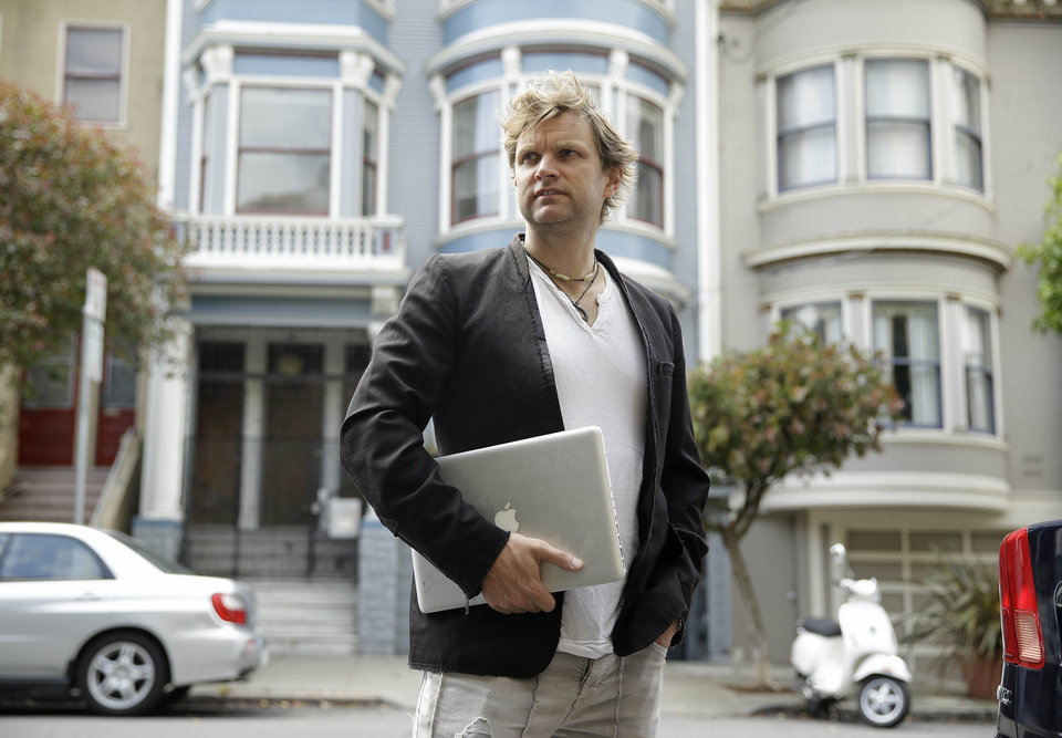 Photo -  Gerry Kelly, founder of clothing brand Sonas Denim and a Bubblews user, poses near his home in San Francisco. Kelly has already earned nearly $100 from Bubblews since he began using a test version in January. His Bubblews feed serves as a journal about the lessons he has learned in life, as well as a forum for his clothing brand. AP Photo   Eric Risberg -  AP